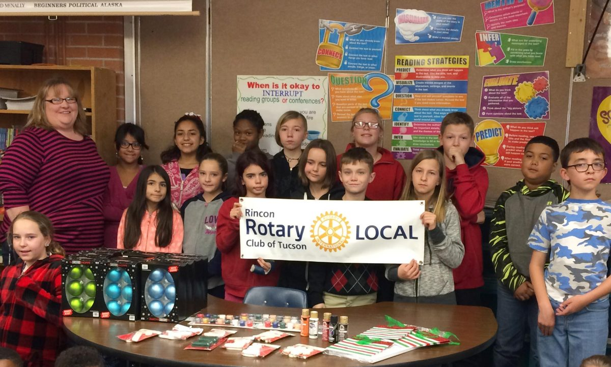 Rincon Rotary decorates the tree for Erickson Elementary.